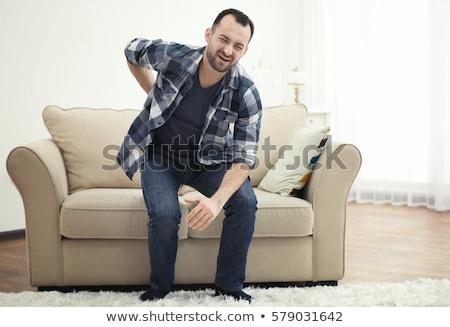 Homem sofá sofrimento homem maduro sessão dor nas costas Foto stock © AndreyPopov