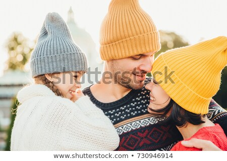 Three family members stand close to each other, look with eyes f Stock photo © vkstudio