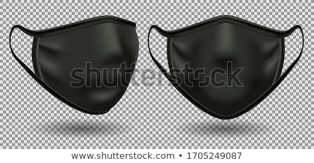 Protective medical mask for face on a black background. Stock photo © artjazz
