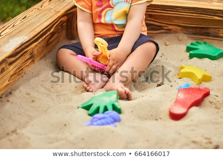 Playing in the sand Stock photo © georgemuresan