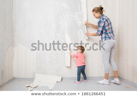 little girl remove old wallpapers Stock photo © Paha_L