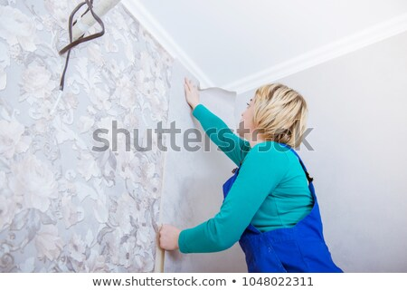 young woman glues wall-paper Stock photo © Paha_L