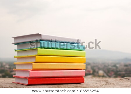 Stack of colorful books laying outdoors Stock photo © AndreyKr