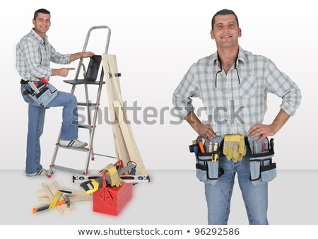 Carpenter stood by ladder with laptop Stock photo © photography33