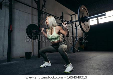 Nő emel súlyzó fitnessz portré fiatal Stock fotó © photography33