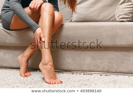 женщину красивой ног сидят диван девушки Сток-фото © ozaiachin