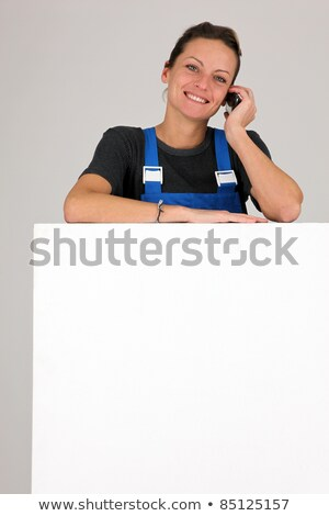 Woman on a cellphone with a board left blank for your message Stock photo © photography33