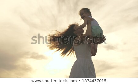 матери вращать ребенка цветок весны трава Сток-фото © Paha_L