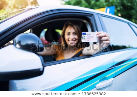 Young brunette with driving license Stock photo © photography33