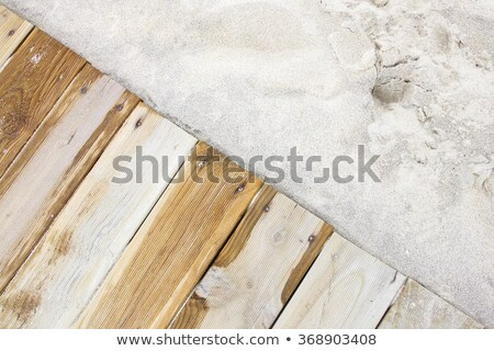 weathered wooden boardwalk on sand stock photo © franky242