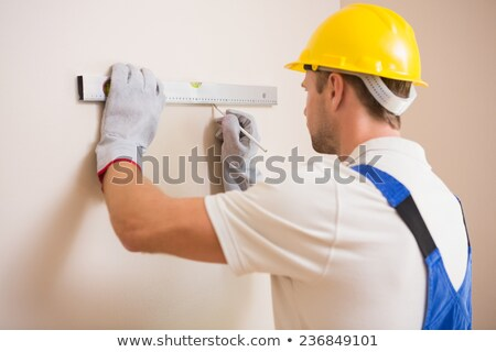 Handyman using spirit level Stock photo © photography33