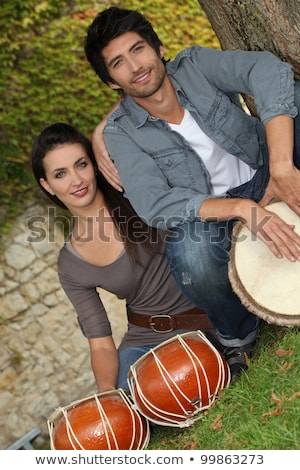 couple playing the drums outside stock photo © photography33