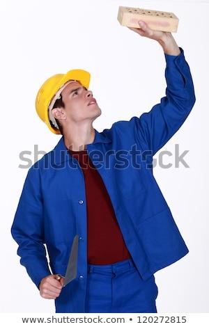 Młodych murarz cegły twarz człowiek niebieski Zdjęcia stock © photography33