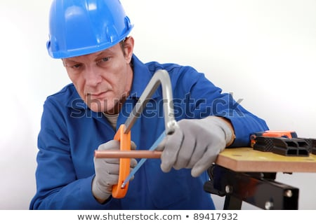 Laborer sawing copper pipe Stock photo © photography33