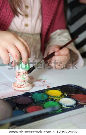 Child painting a plaster figurine Stock photo © photography33