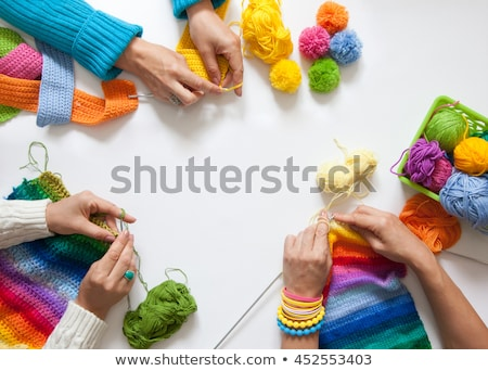Hands of a woman knitting with pink wool  Stock photo © frank11