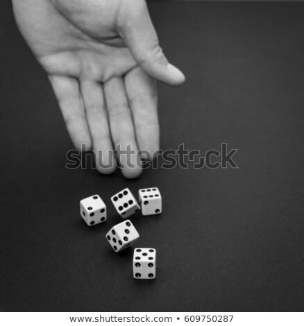 Gambler five dices in human hand Stock photo © lunamarina