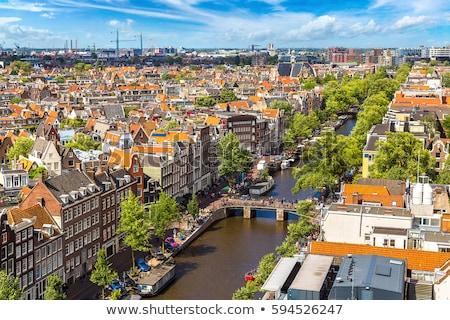 市 アムステルダム オランダ 運河 歴史的 アパート ストックフォト © rognar