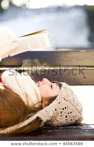 Woman lying on bench and enjoys reading Stock photo © vetdoctor