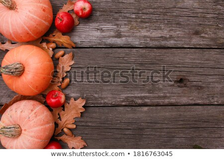 red apples on old shabby wooden background Stock photo © TarikVision