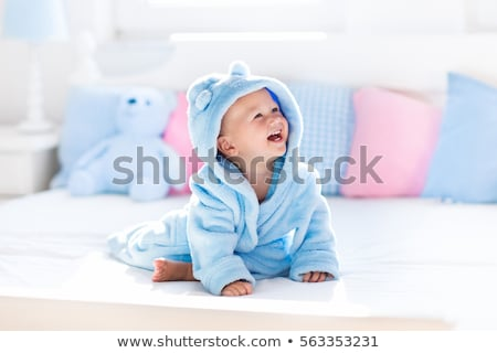 Cute baby boy on a bed playing Stock photo © Len44ik