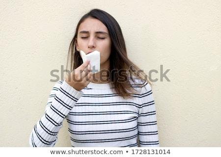 Pretty woman mouth blowing cold breeze Stock photo © ra2studio