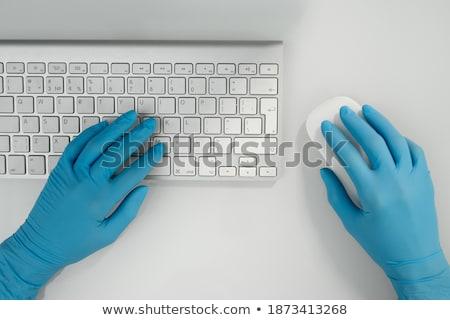 Doctor pressing modern medical type of button Stock photo © ra2studio