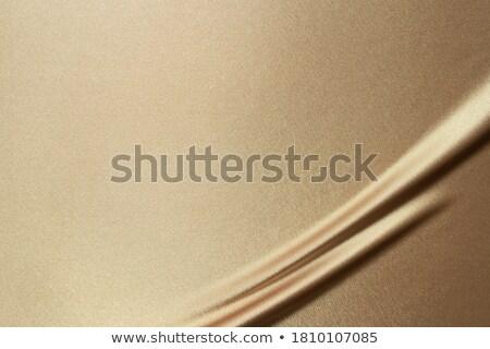 Gouden zijde satijn textuur donkere golvend Stockfoto © jamdesign