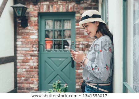 Smiling woman rely on wall from brick Stock photo © vetdoctor