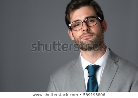 head of young man with smug expression Stock photo © feedough