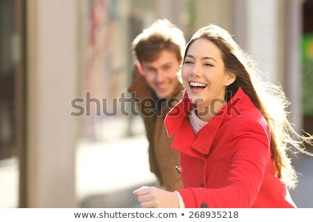 Casal adolescentes corrida jeans menino sorridente Foto stock © ambro