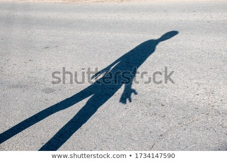 Strangers shadow on pavement Stock photo © Nejron