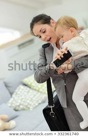 Businesswoman running late  Stock photo © ichiosea