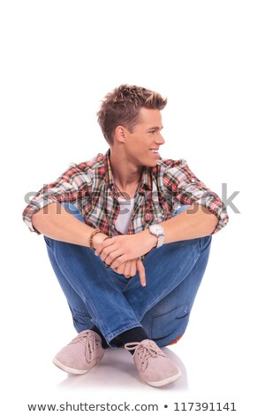 seated casual man looks away to his side stock photo © feedough