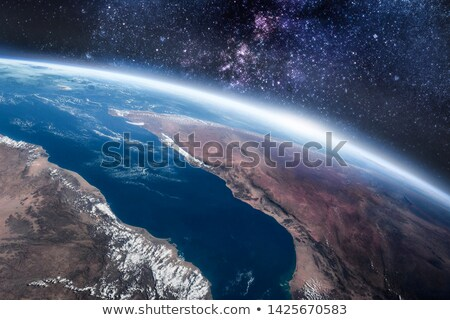 Earth's surface and clouds Stock photo © cherezoff