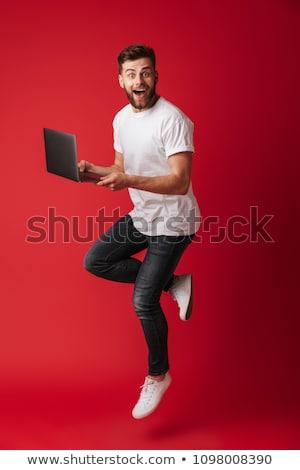 Surpresa homem laptop isolado branco estresse Foto stock © Mikko