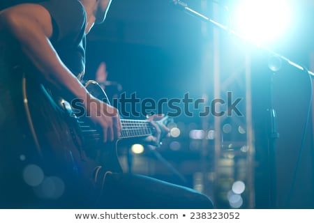 rock musician with expression playing electric bass guitar Stock photo © feelphotoart