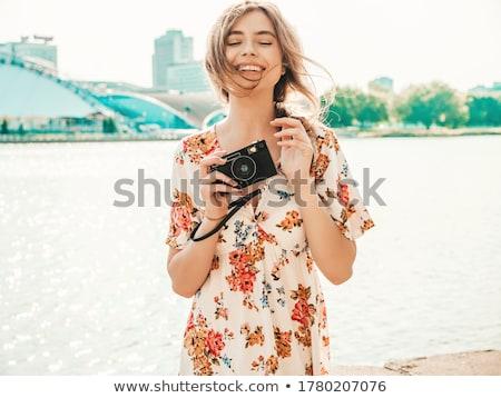 Szexi fiatal nő tengerpart napozás nő égbolt Stock fotó © sarymsakov