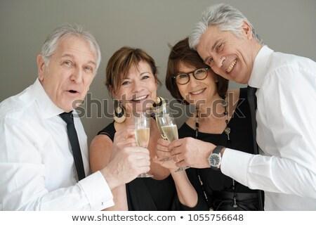 couple dressed up for party celebration Stock photo © godfer