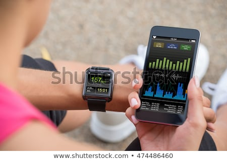 runner looking at heart rate monitor smart watch stock photo © maridav