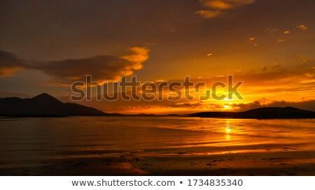 Vad út Írország narancs naplemente hajók Stock fotó © morrbyte
