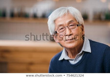 Asiático senior homem celebrar ano novo chinês retrato Foto stock © yongtick
