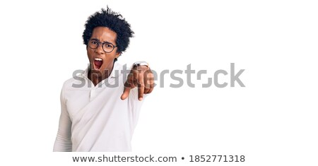 serious afro american man in fashion cloth and glasses stock photo © deandrobot