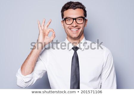 вызывать · счастливым · молодым · человеком · рубашку · знак - Сток-фото © Patramansky