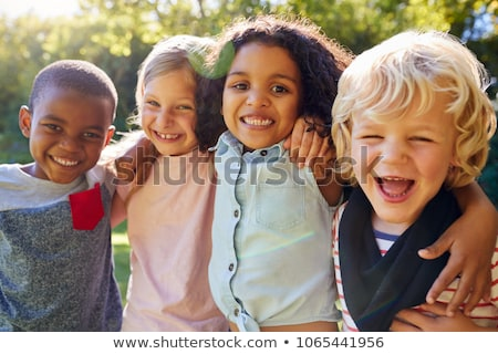 Four children group with arms up Stock photo © zurijeta