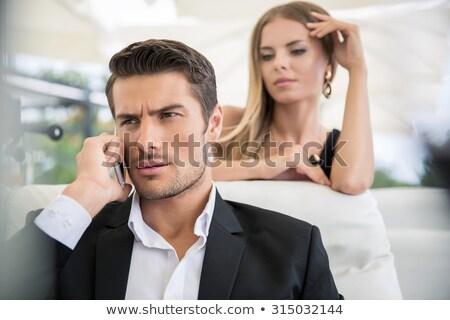 jóképű · üzletember · dolgozik · mobiltelefon · izolált · fehér - stock fotó © deandrobot