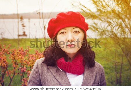 Poetic portrait of beautiful young brunette in autumn park. Stock photo © lithian