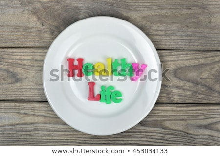 Healthy life word on plate Stock photo © fuzzbones0