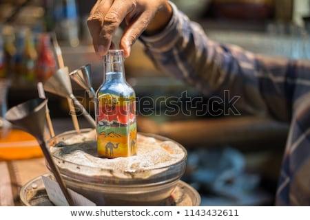 Zand boom hand glas fles Rood Stockfoto © zurijeta