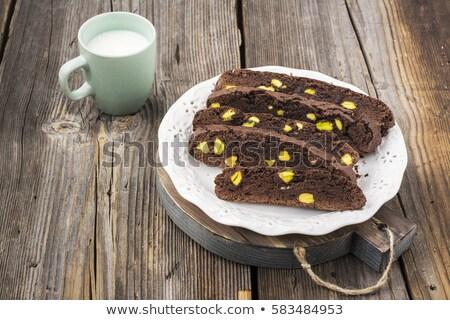 Csokoládé pisztácia diók keksz darab ruha Stock fotó © faustalavagna